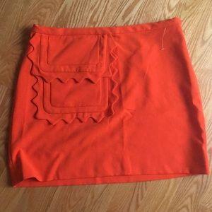 "Orange ""mod"" style mini skirt"